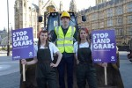 Oxfam activists protesting against land grabs